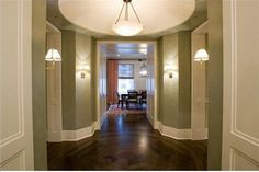 Similar to the colors our foyer will be: dark wood floors with greyish green walls white trim. Dining Room Paint Colors, Paint Colors For Home, Floor Decal, Dark Wood Floors, Foyer Design, Diy Molding, Living Room Remodel, Great Rooms, Home Projects