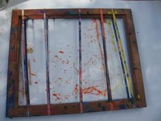 snap paintings - paint rubber bands on old frame, snap them to release paint onto paper underneath