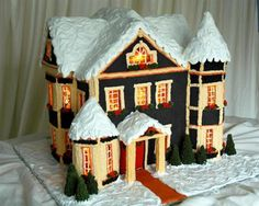 Snow-Capped Gingerbread House: For an advanced project, light an intricate gingerbread house (poured sugar windows are a must) from within with mini string lights.  Source: Rock Recipes