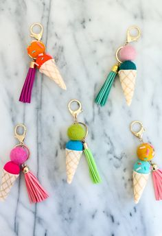 Make your own DIY Felt Ball Ice Cream Cone Keychains using felt balls and hot glue! A perfect craft for selling at craft shows or for as favors at a party! Easy Diy Crafts, Creative Crafts, Crafts To Make, Tape Crafts, Resin Crafts, Kids Crafts, Diy Keychain, Keychains, Keychain Ideas