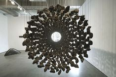 Manipulating Natural Materials Into Suspended Stone Installations - http://freshome.com/2012/06/11/manipulating-natural-materials-into-suspended-stone-installations/