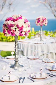 Gorgeous pink and ivory centerpiece for wedding in Bali at Alila Villas Uluwatu, photo by Marcus Bell of Studio Impressions | junebugweddings.com