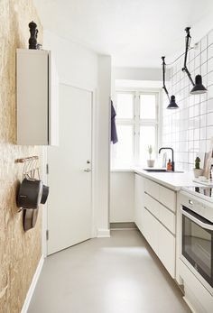 love the osb board wall in this kitchen
