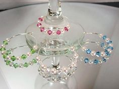 Hey, I found this really awesome Etsy listing at http://www.etsy.com/listing/80208658/crystal-pearl-wine-glass-charms-rings