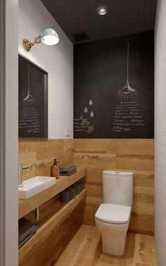 Un mur ardoise pour une touche originale dans les toilettes