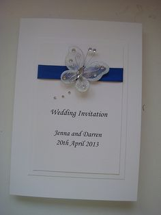 Wedding Invitation with an organza butterfly and satin ribbon. Shown in white and royal blue
