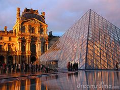 The most visited museum in the world, Louvre in Paris, France in a magnificent golden hour light just after some spring rain with reflection in a pond at the base of Louvre Pyramid, the new entrance to the museum. Its history goes back 800 years of continuous transformations from fortress to palace and today museum.  Mona Lisa by Leonardo Da Vinci is only one of the works of art exhibited today inside.