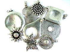 Beautiful Pewter Pendants from Turkey!! Find them at www.happymangobeads.com. #metal #necklace #beads
