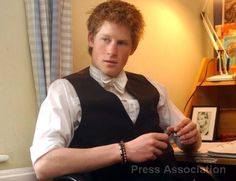 Note the framed picture of Diana on Prince Harry's desk at Eton.