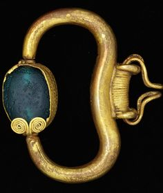 Pendant Maker unknown 600BC-500BC Phoenicia Gold, set with green glass Museum no. M.134-1919 © Victoria  Albert Museum, London