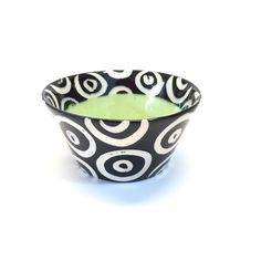 Small Flared Bowl in Green by Matthew A. Yanchuk. Slip-cast and glazed white earthenware bowl with a high-gloss finish. Painted by hand. Food and microwave safe; not oven safe. Hand wash. Stamped with the artist's signature on bottom.