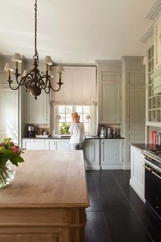 I thought it might be nice to ease into the weekend with a beautiful kitchen image.  I love the softness of the cabinetry and the contrast of the natural wood- um and the floor is fabulous! Have an