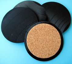 Vinyl Record Coasters!  Vinyl records can be found in abundance at auctions!  What a great upcycle / recycle/ repurpose idea.