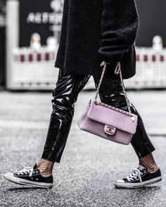Patent leather trousers and soft pink Chanel bag! Nice she stylish she walks the walk, she belongs in this closet.