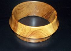 Handmade African tribal inspired wood bracelet by DonBurdaDesign, $48.00  https://www.etsy.com/listing/187431131/handmade-african-tribal-inspired-wood?