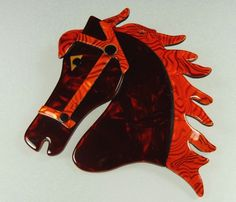 Lea Stein horses head brooch - with red trim. Photographed by Gillian Horsup