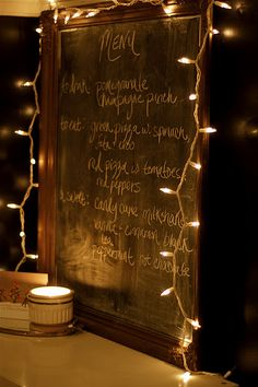 chalk board menu with string of white lights. Lovely.
