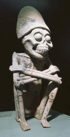Mictlantecuhtli was the Aztec god of death and the underworld.... He looks way happy though!!!