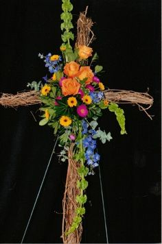 cross made from flowers | We can make it larger ( 36 inch cross) with more flowers for $350. and ...