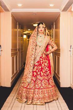 Bridal Wear - Red Bridal Lehenga with Double Dupatta | WedMeGood | Bridal Lehenga with Emerald and Polki Set #wedmegood #indianbride #indianwedding #lehenga #bridal #dupatta