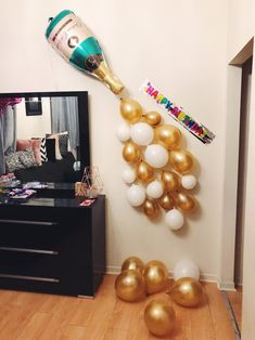 Birthday party decor: popping champagne balloons