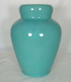 California Faience, corseted vase, shape # 49, bright Persian Blue glaze, ca. 1915-1933, 10 3/4″ high.