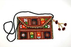 Check out this item in my Etsy shop https://www.etsy.com/uk/listing/469840600/indian-tribal-banjara-clutch-bag-gypsy