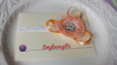 Baby headband with orange flower by tinylovegifts on Etsy, $8.50