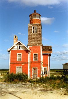 Mispillion Lighthouse on the Mispillion River near Delaware Bay, Delaware, USA. The steel skeletal tower remains at the original location but is not active or open to the public. It was added to the National Register of Historic Places in Old Abandoned Houses, Abandoned Places, Old Houses, Old Buildings, Modern Buildings, Lighthouse Pictures, Beacon Of Light, Ghost Towns, Historic Homes