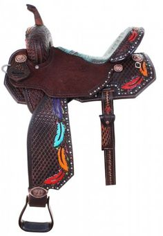 Brown vintage 3/4 tooled Pozzi Pro Barrel Racer with a combination of southwest diamond and hand-painted feather tooling. This show-stopper has a mixture of turquoise, copper, and silver dots along the edges as well as a turquoise and brown Caiman gator seat. Included with this saddle is a leather horn, adjustable 3 way in skirt rigging, brown aluminum stirrups, and copper Indian conchos.