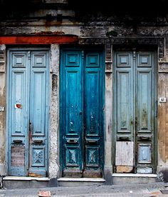 Trio of dilapidated doors