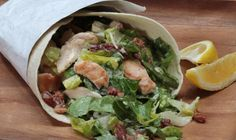 Create your usual chicken caesar salad and then place it in a wrap! - Fall, Cheese, Bacon, American, Winter, Lunch, Sandwich, Summer, Chicken, Spring, Leafy Green, Tortilla
