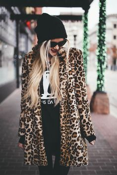 Oversized leopard jacket and black beanie. Winter wardrobe street style.