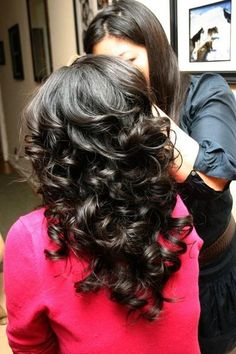 flat iron curls...a lady that goes to church with me did this to her hair and I loved the look! All the curl and body of hot rollers in half the time!