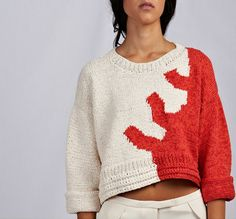 """Paris-based designer Risto's spring collection is full of dreamy hand-knit sweaters. His inspiration? the sea! """"The Risto girl loves the city. She lives it, breathes it. But when she dreams, where does she go? The sea, of course – and the beach."""""""