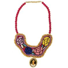 The charm of this colorful hand embroidered bib necklace made in Oaxaca City, Mexico is how it harmoniously blends traditional and contemporary styles. The idea behind this artful piece, designed by local Oaxacano Gabriela Vilchis, is to highlight the magical, time-honored artistic work of the local women yet present it to the modern day woman in a way that she can adapt it to her wardrobe and lifestyle.  We love the extra detail of the Frida Kahlo with a cat pendant framed in sparkling…