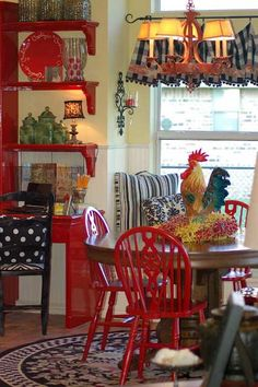 Country dining area with red and rooster! Colorful fun and bright~~Love it lr