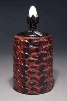 A Wave Box made of Kingwood, African Blackwood & Tagua Nut. Made on the Rose Engine Lathe.by Jon Sauer.