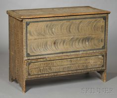 Paint-decorated Chest over Drawer, possibly southeastern Massachusetts, late 18th century, the hinged molded lid above a case with thumbmolded drawer, and cutout ends, original surface of gray paint with black feathering and borders, (imperfections), ht. 34, wd. 42, dp. 19 1/4 in.