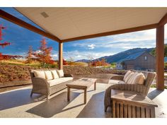 This patio space consists of two couches and a retractable outdoor roof. The views make this backyard a perfect location for a summer evening. Millbrook Resort, Two Couches, Backyard, Patio, Outdoor Furniture Sets, Outdoor Decor, Property For Sale, My House, Outdoor Living