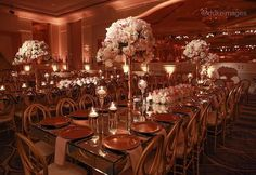 Lighting add a romantic mood to a room filled with elegant centerpieces ~ Amber Event Production