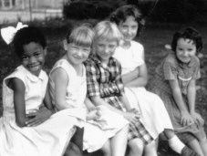 Ruby Bridges with her friends | Ruby Bridges, 1960 Ruby Bridges (born 1954) was the first African American child to desegregate an elementary school when she walked into William Frantz Elementary school in New Orleans, Louisiana in 1960.