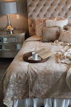 Parade of Homes 2014 - Wichita, KS.  Winner of Decorating/Merchandising/Color. Creamy, dreamy bedroom in luxurious fabrics.  Custom bedding and headboard with a mirrored dresser and silver lamps flanking the bed.  Ready to jump right in!  Designed and Furnished by Design Source Interiors.