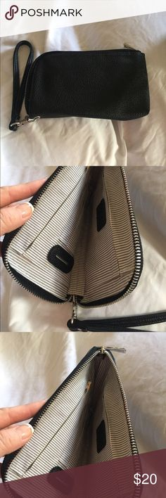 Black Clutch/Cell Phone Charger/Wristlet NWOT- Clutch that carries your cell phone, credit cards, lip gloss, etc... All while charging your battery.  Too cute! Too neat!  Love mine! Bags Clutches & Wristlets