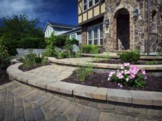 Pavers aren't just for the backyard. From walkways to driveways, and even retaining walls, Belgard adds interest and intrigue.