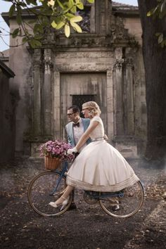 "Who wouldn't want to ride a bike with Matthew Christopher? Especially if you were wearing his ""Joy"" gown!"