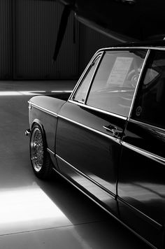 BMW 2002: Beautiful as automobile aesthetic, as art/photography. A purposeful blend of shade, bright work and aesthetic.