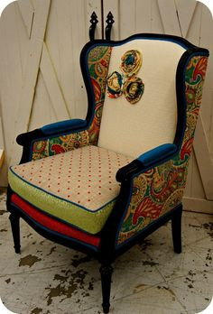 Gorgeous antique chair that underwent an interesting upholstery job. Might be cool to do something like this in all black/white or teal for the Girl's room.