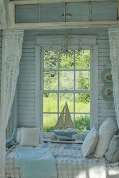 Country Cottage Style light blue and white window with toy sailboat