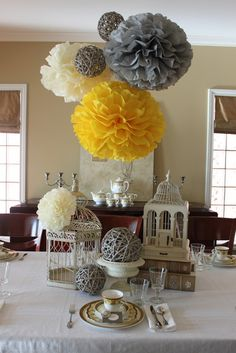 Love hanging centerpiece....spray paint grapevine balls the color scheme of party!